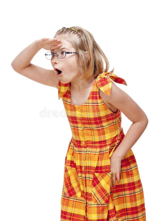有金发和玻璃看的小女孩 图库摄影