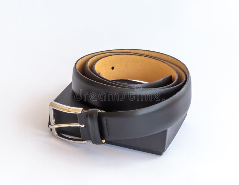 有金属扣和它的黑纸板的pac黑皮带 图库摄影