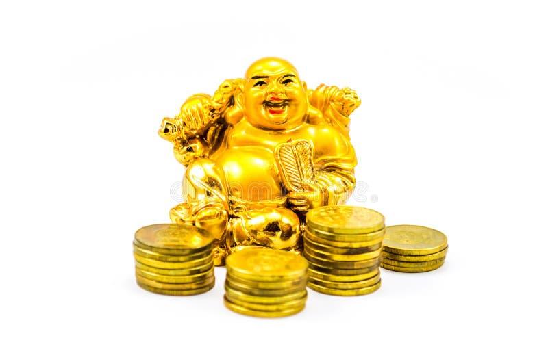 有金币的笑的菩萨 库存图片