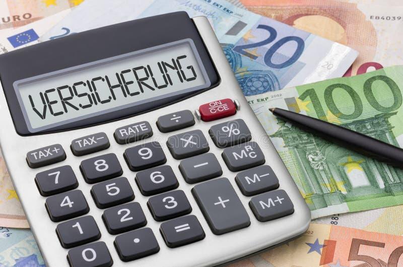 有金钱保险的- Versicherung德语计算器 库存图片