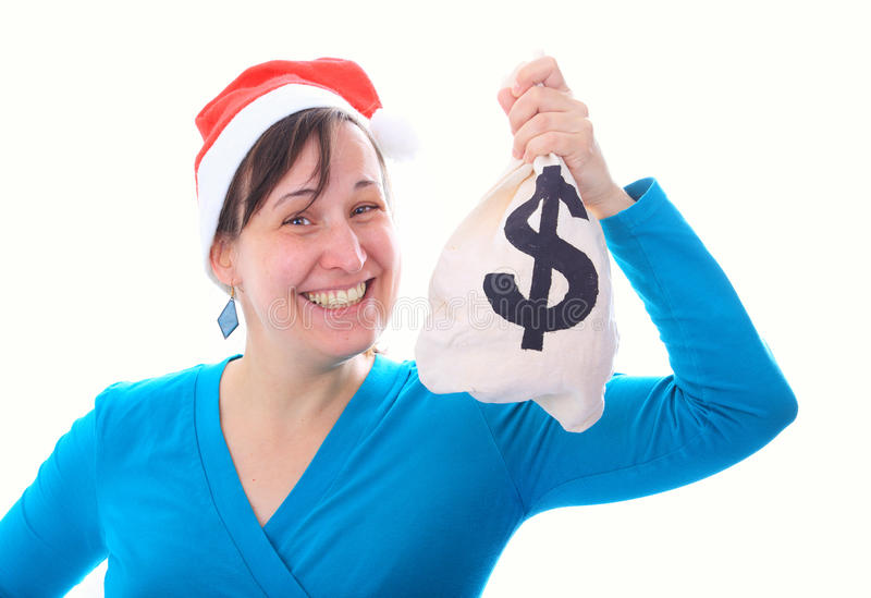 有金钱大袋的年轻圣诞老人女孩 图库摄影