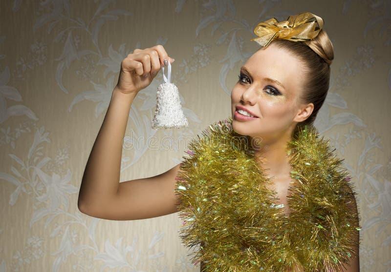 有金黄圣诞节样式的妇女 免版税库存图片