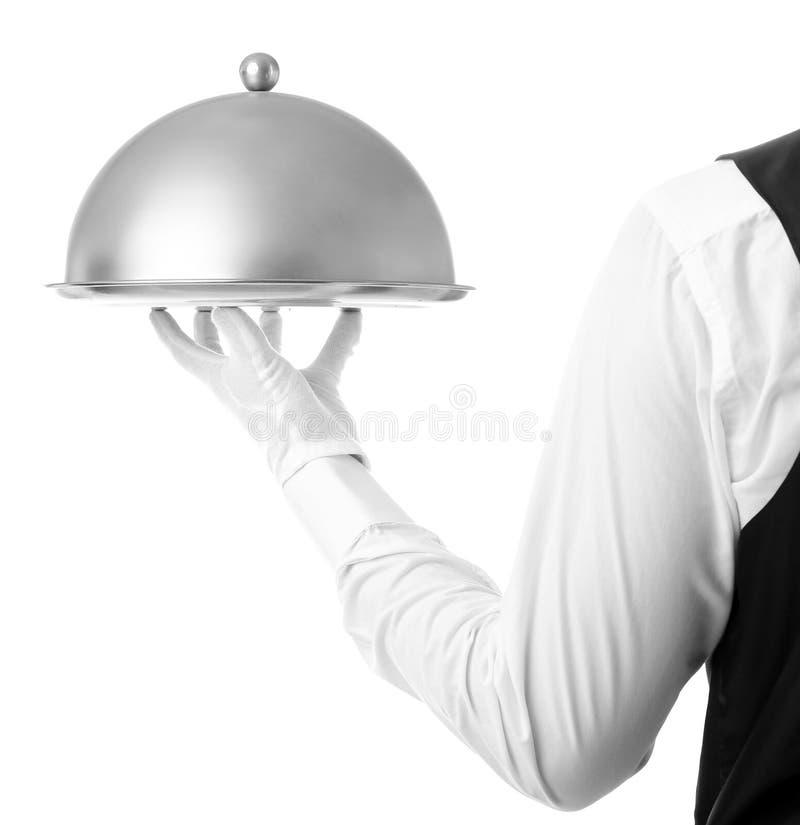 有钓钟形女帽和盘子的侍者手 库存图片