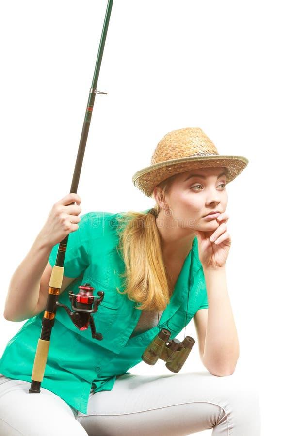 有钓鱼竿的,转动的设备乏味妇女 免版税库存照片