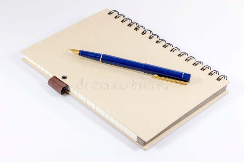 有钢笔的笔记本 图库摄影