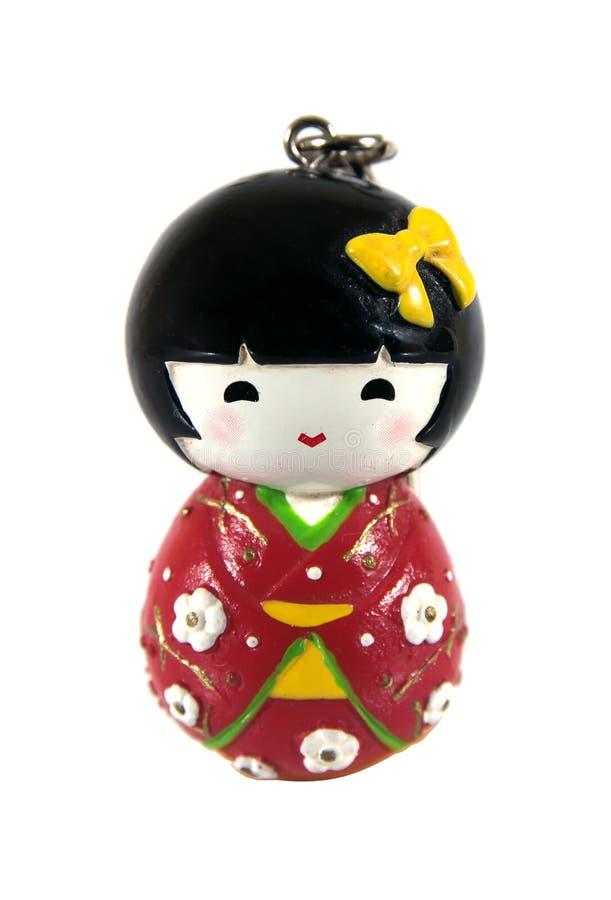 有钥匙圈的日本kokeshi玩偶被隔绝的由木头制成在白色背景 免版税库存图片