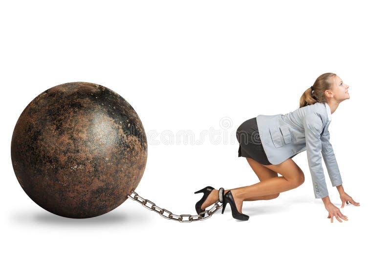 有铁球的女实业家 免版税图库摄影