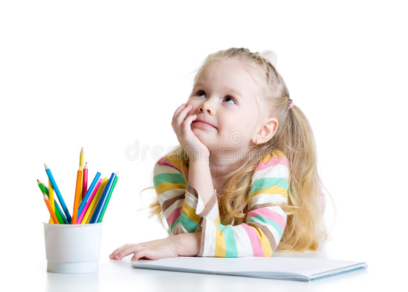 有铅笔的梦想的儿童女孩 免版税库存图片