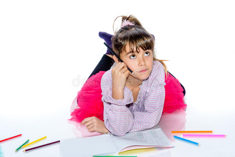有铅笔的梦想的小女孩 库存照片