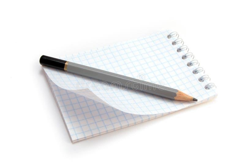 有铅笔的笔记本 免版税库存图片
