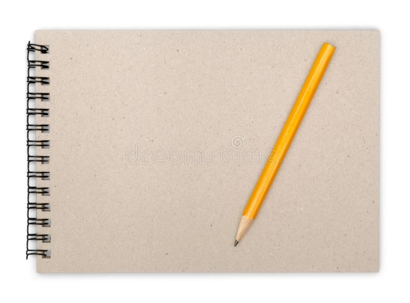 有铅笔的被打开的笔记本在白色背景 免版税库存照片