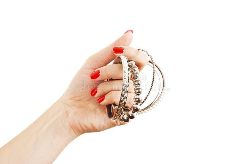 有银色手镯的妇女手 免版税库存图片
