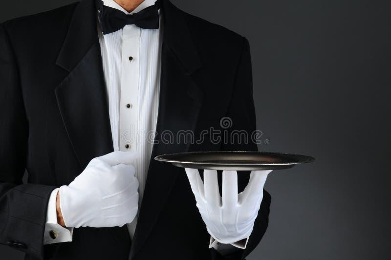 有银色盘的等候人员 库存图片