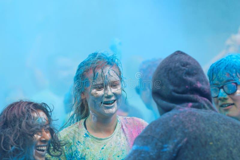有银色颜色的微笑的女孩在她的面孔 免版税图库摄影