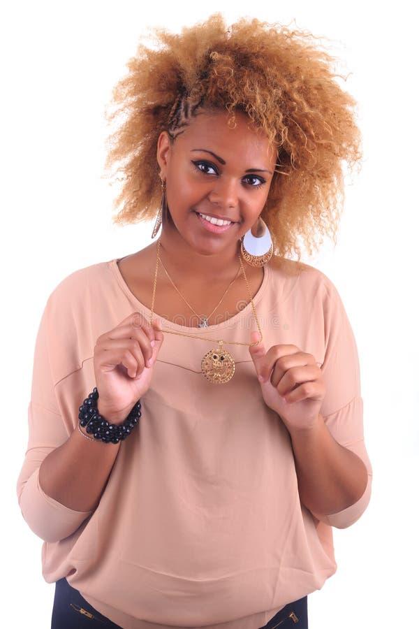 有长期的美丽的非洲妇女haircurly 图库摄影