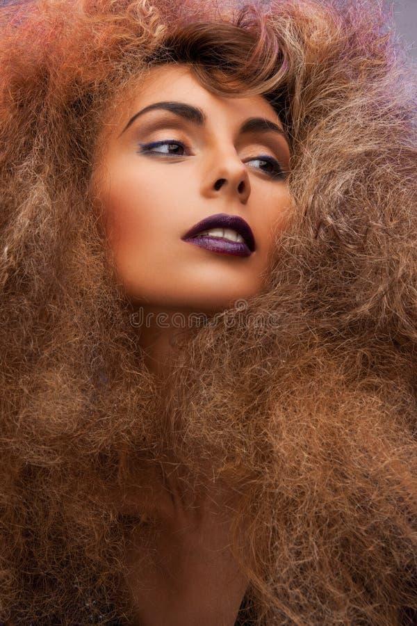有长的卷发的妇女 图库摄影