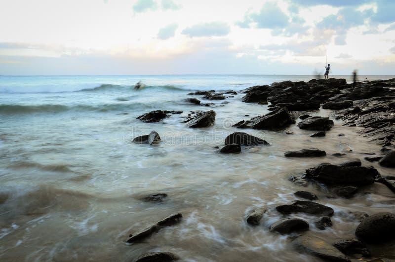 有长的曝光海景的渔夫 免版税库存图片