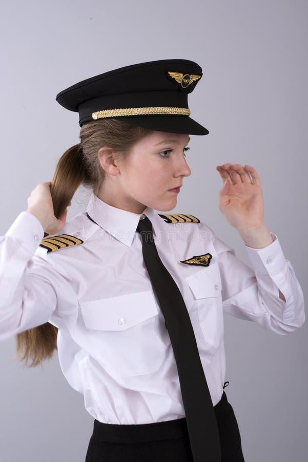 有长的棕色头发的年轻飞行员 库存照片