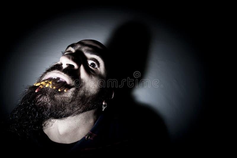 有长的牙的怪异人 库存照片