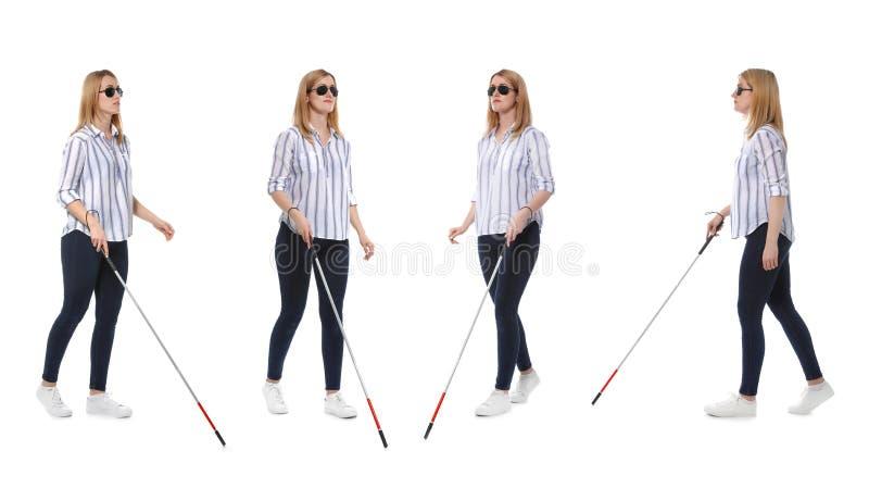 有长的藤茎的盲人妇女走在白色的设置  库存照片