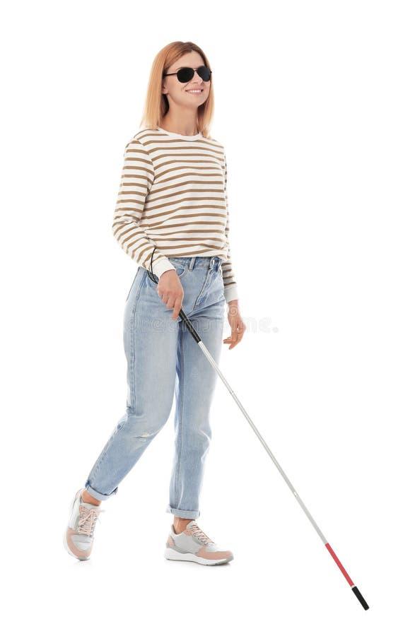 有长的藤茎的盲人走在白色的 图库摄影