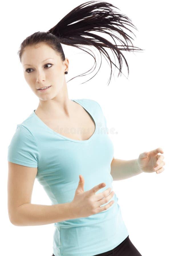 有长的头发的运动的妇女 免版税图库摄影