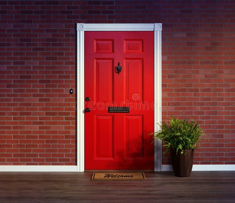 有门垫的邀请的红色大门 库存图片