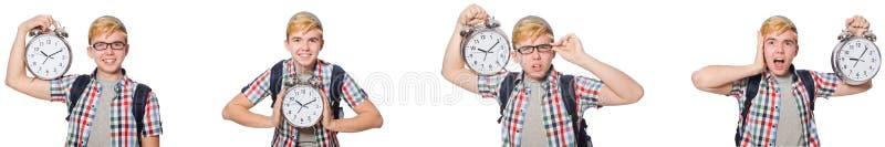 有闹钟的年轻男孩在时间管理概念 免版税库存图片