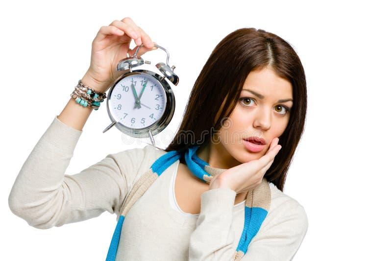 有闹钟的惊奇妇女 免版税库存图片