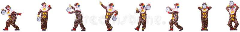 有闹钟的滑稽的男性小丑 免版税库存照片