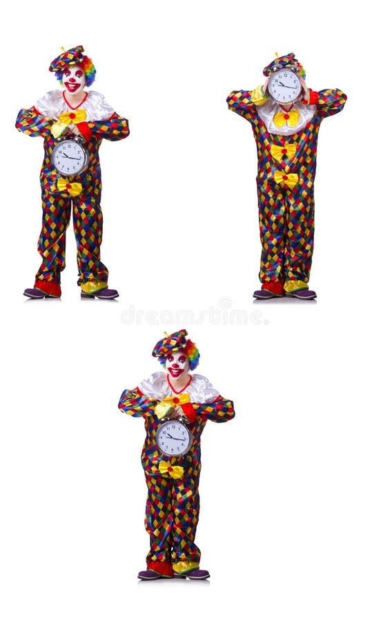 有闹钟的滑稽的男性小丑 库存照片