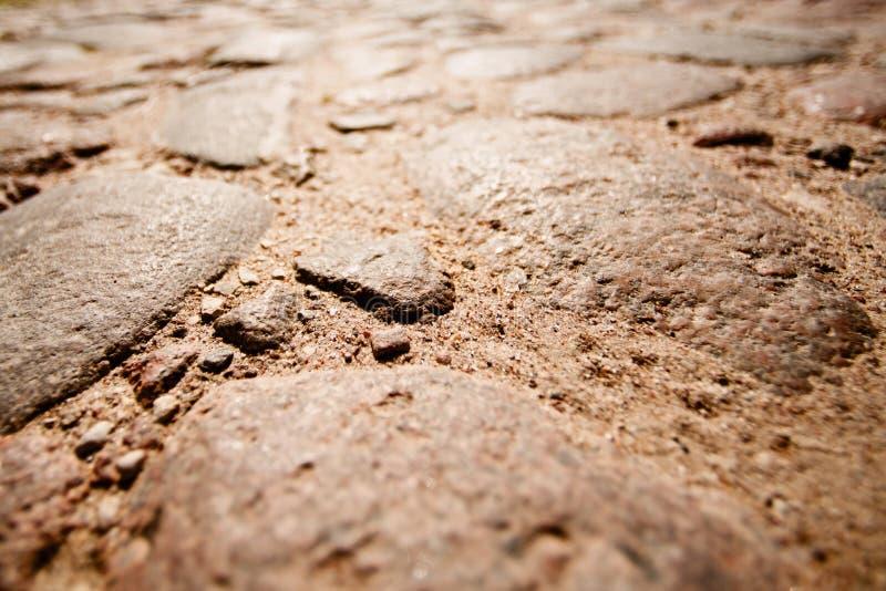 有阳光的石路 免版税图库摄影