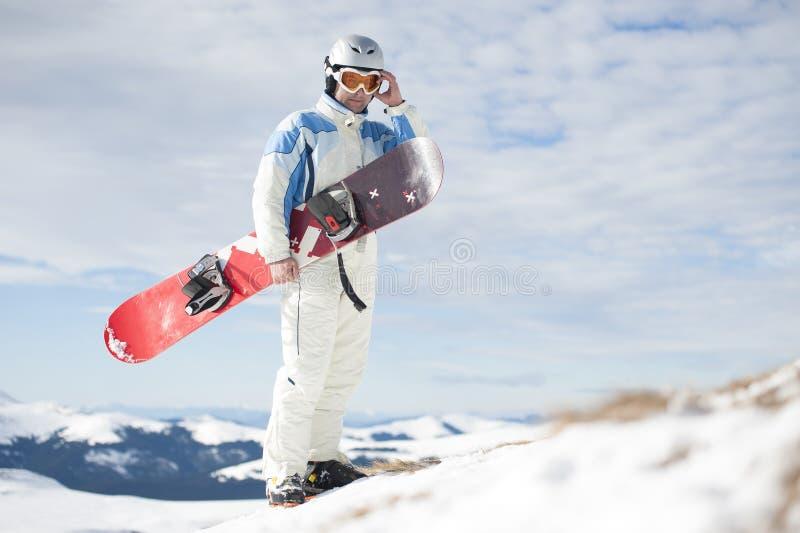 有雪板的人 免版税库存图片