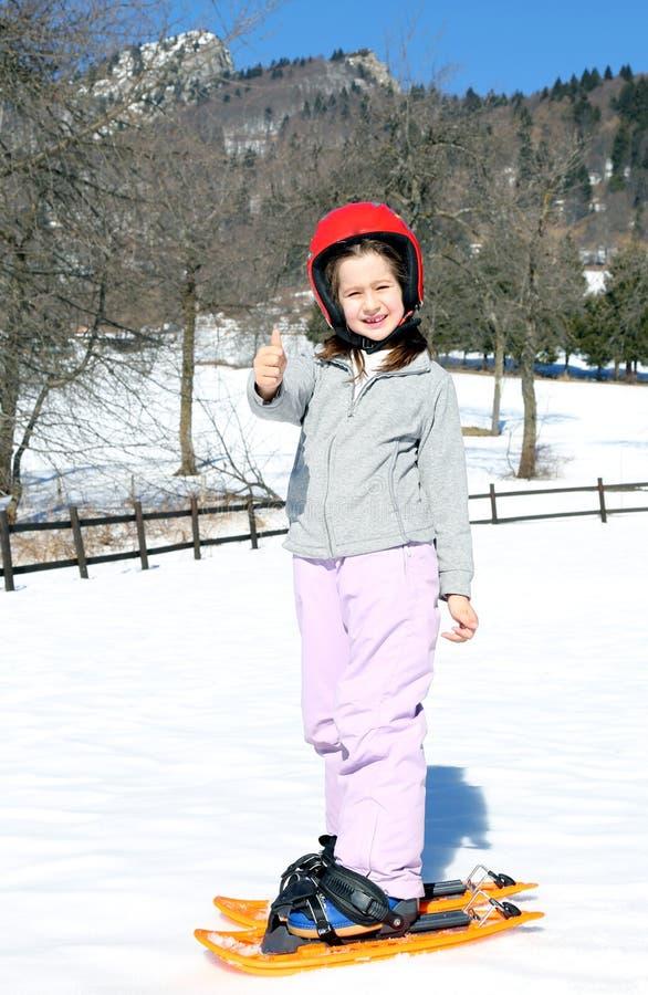 有雪靴的小女孩 免版税库存图片