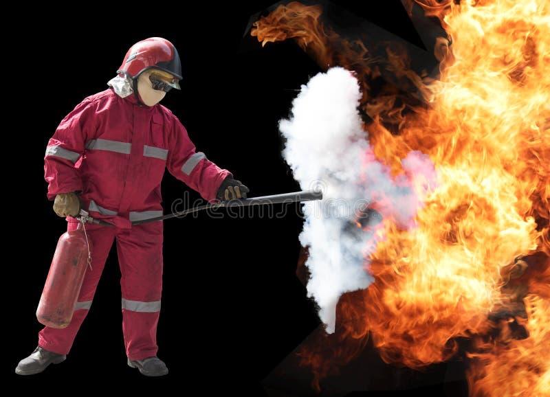 有面具的消防队员和充分地在火backgrou的防护套服 免版税库存图片