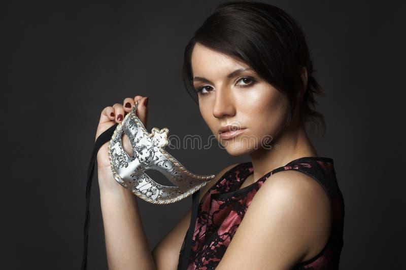 有面具的美丽的性感的少妇 免版税图库摄影