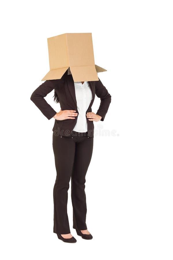 有顶上的箱子的女实业家 免版税图库摄影