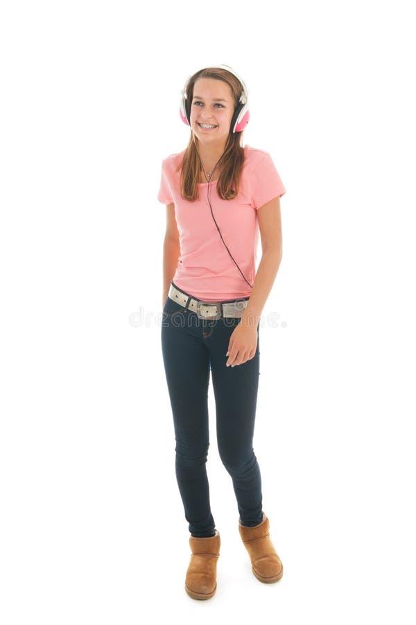 有顶头电话的青少年的女孩 库存图片