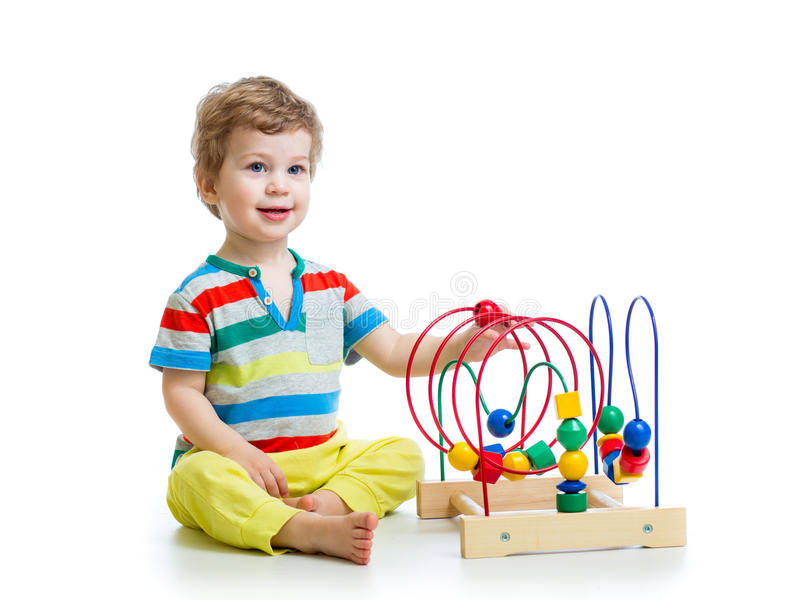 有颜色教育玩具的俏丽的婴孩 免版税库存照片