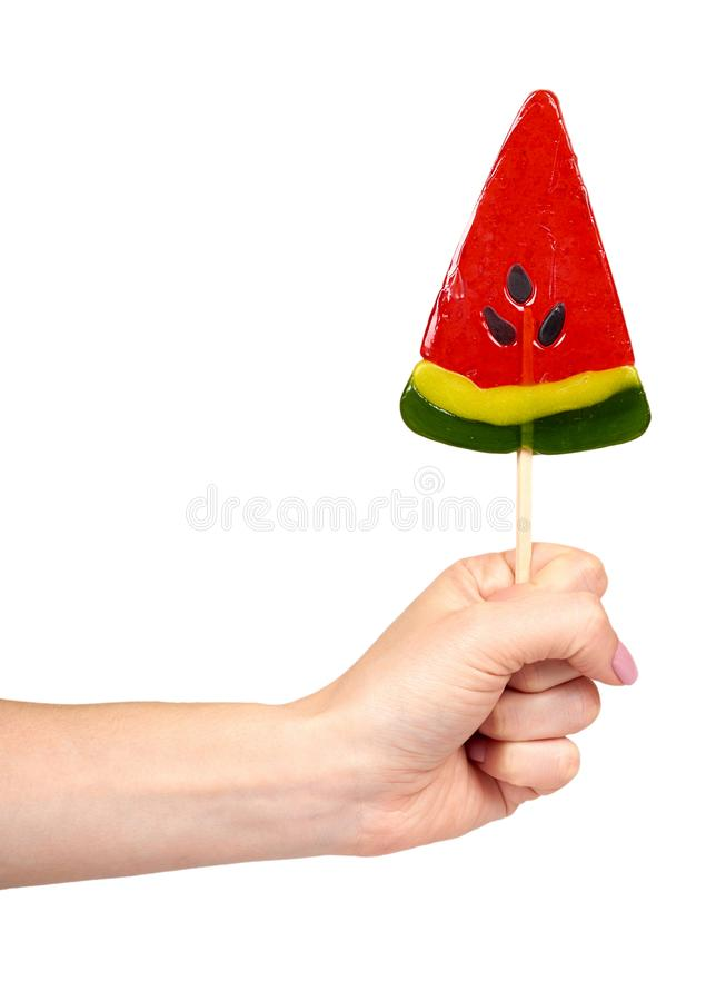 有颜色棒棒糖的,明亮的凉快的糖果,西瓜形状手 免版税库存照片