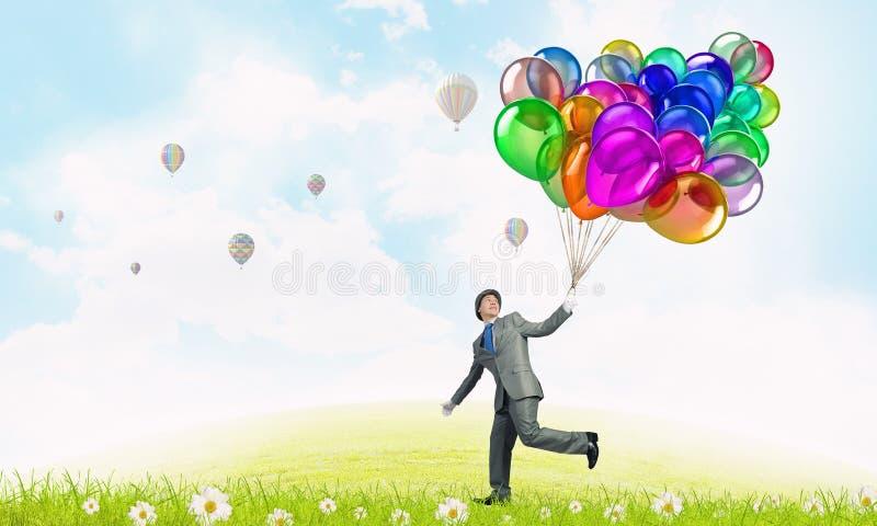 有颜色气球的喜剧演员人 库存照片