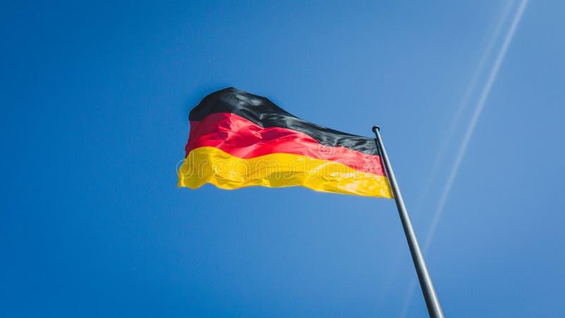 有风德国旗子 免版税库存照片