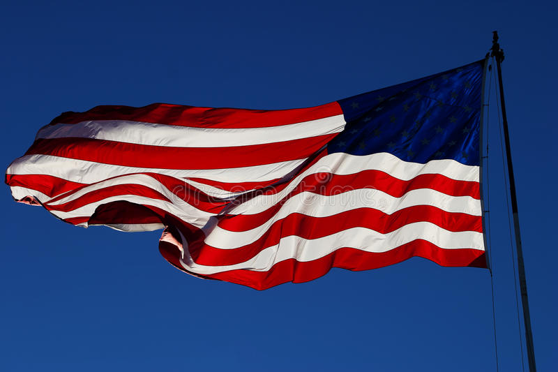 有风我们旗子后面光4 库存照片