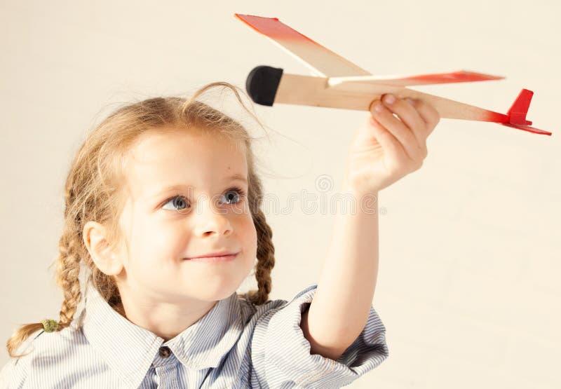 有飞机的女孩 库存照片