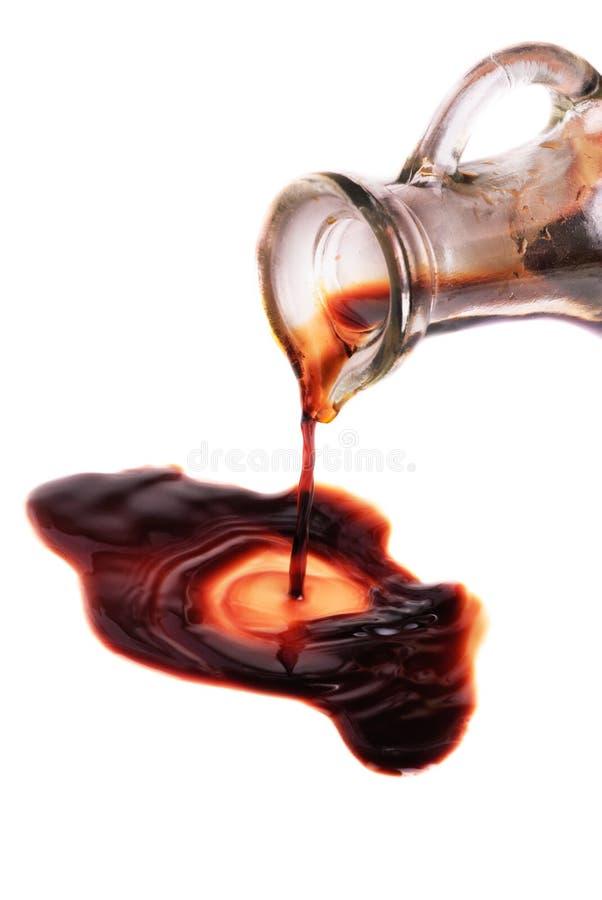 有香醋的蒸馏瓶 免版税库存图片