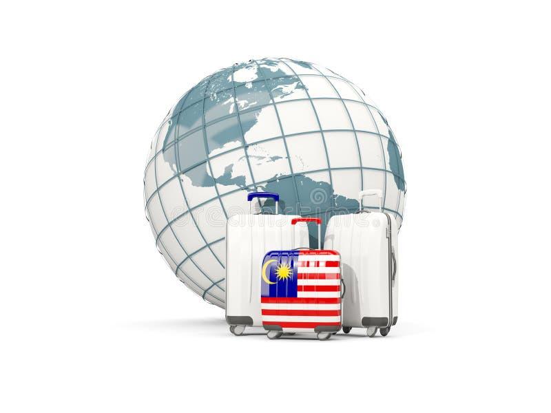 有马来西亚的旗子的行李 在地球前面的三个袋子 库存例证