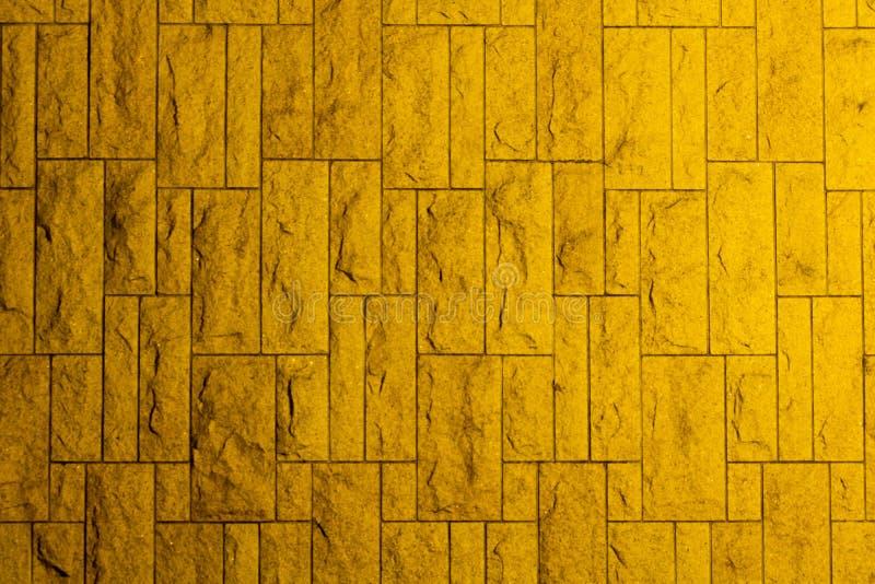 有黄色砖的墙壁 免版税库存照片