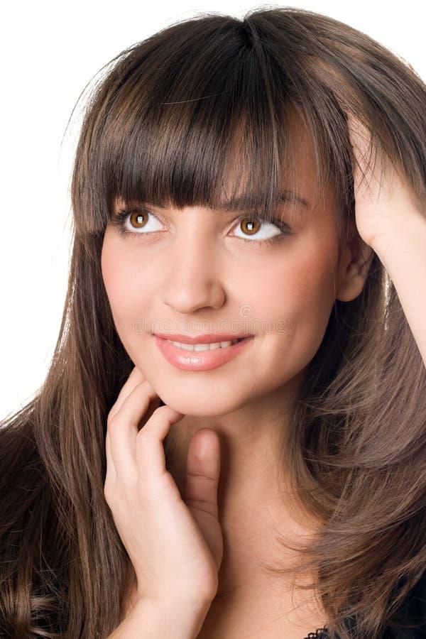 有黑发和棕色眼睛的体贴的妇女 库存图片