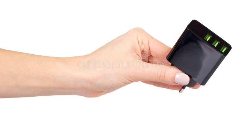 有黑USB墙壁chrger插座的,三个口岸手 免版税库存图片