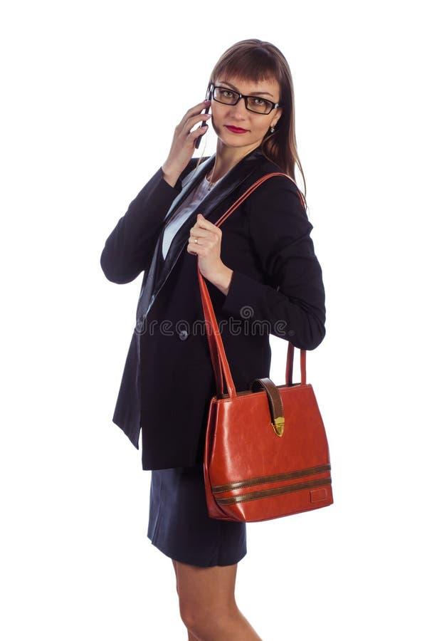 有移动电话的女商人 库存图片